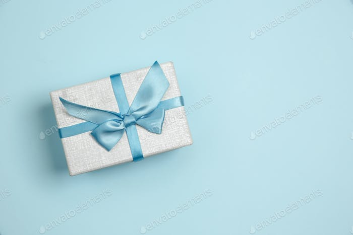 Gift, present box. Monochrome stylish composition in blue color. Top view, flat lay