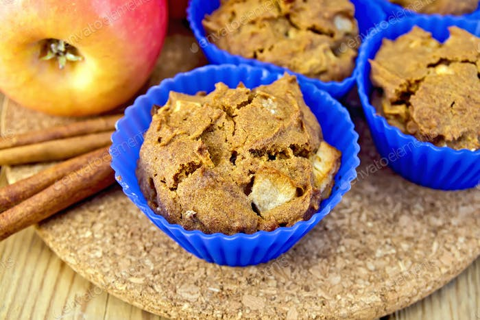 Cupcake rye with apple in tins on board