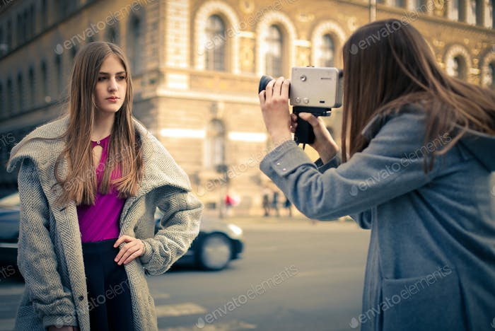 Girl filming another girl