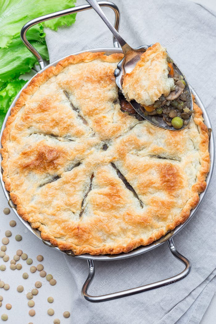 Vegetarian pot pie with lentil, mushrooms, potato, carrot and gr