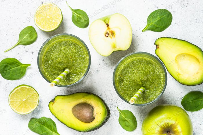 Green smoothie from fruit and vegetable on white