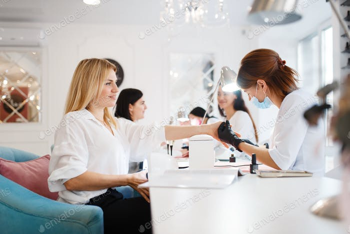 Thumbnail for Group of girlfriends, manicure in beauty salon