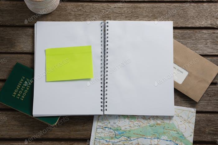 Passport, map, organizer and envelope on wooden table