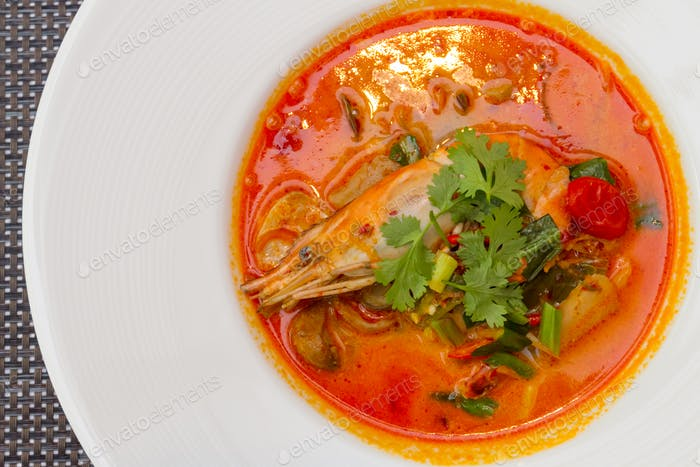 Tom Yum Goong or spicy soup with shrimp. Thai food