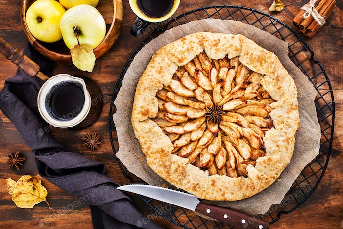 Apples and cinnamon rustic open pie (galette), top view