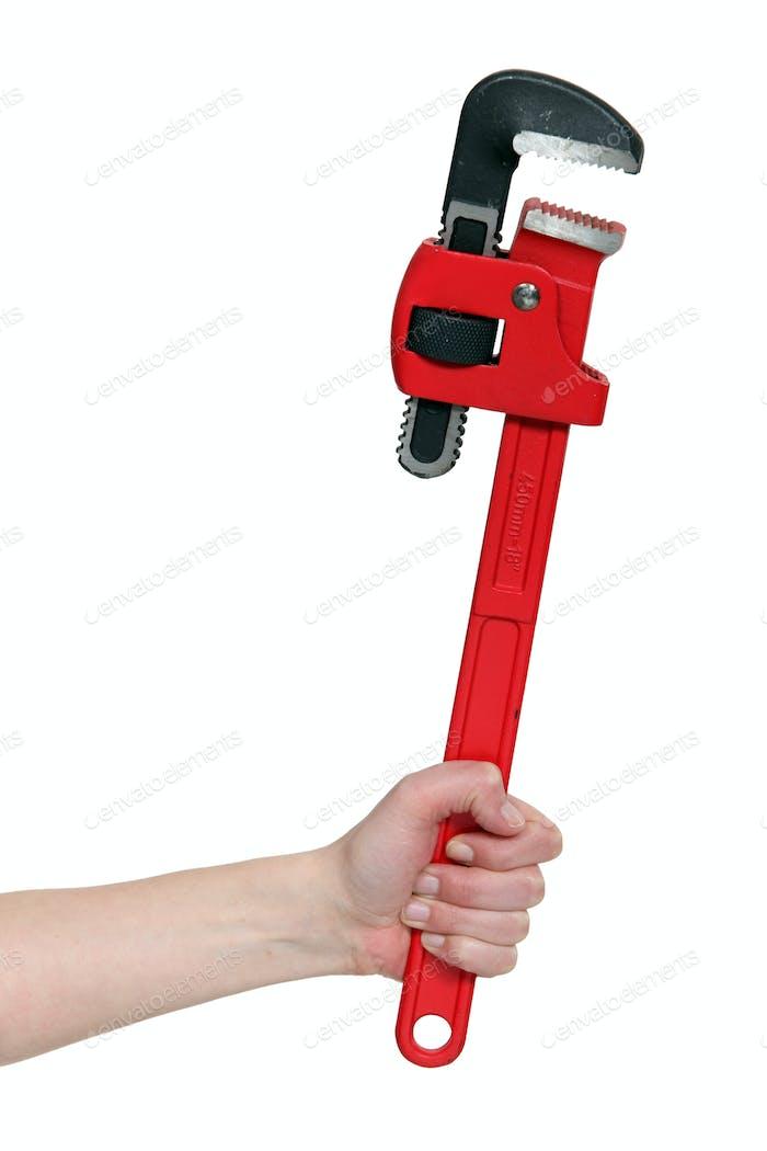 Nahaufnahme der weiblichen Hand Hand mit verstellbarem Schraubenschlüssel