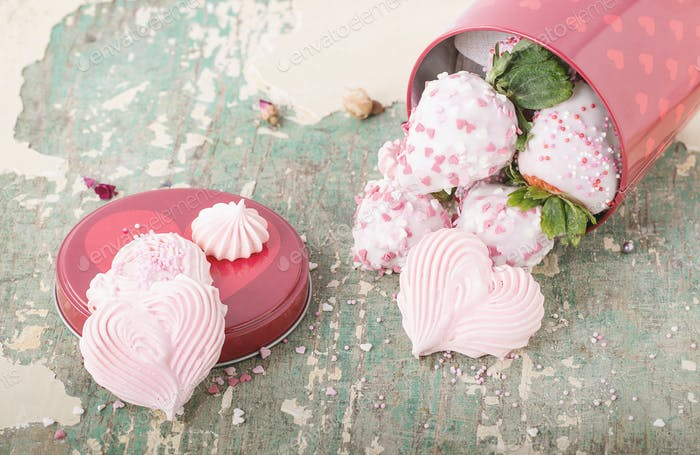 Yogurt glazed strawberries with heart shaped meringues