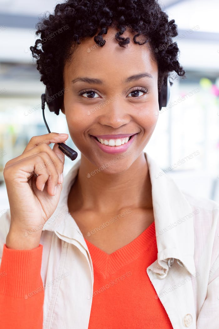 African-american female customer service executive with headset looking at camera