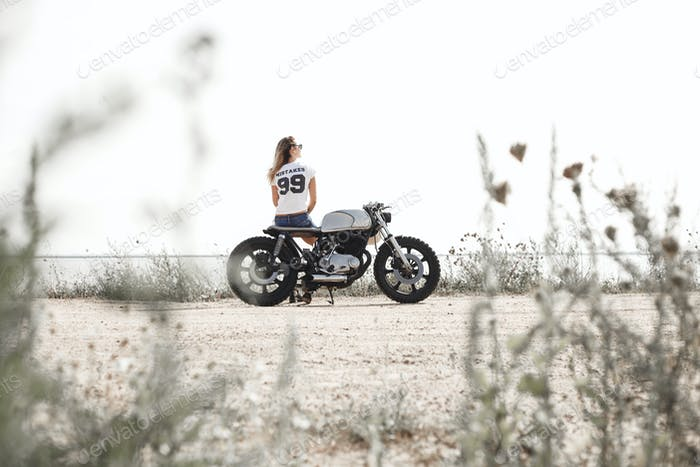 Woman and motorcycle on road