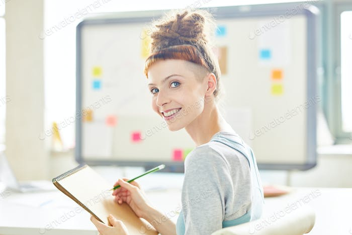 Cheerful attractive startupper in board room