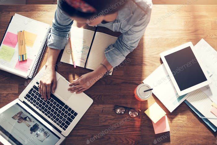 Businesswoman working and typing laptop in office