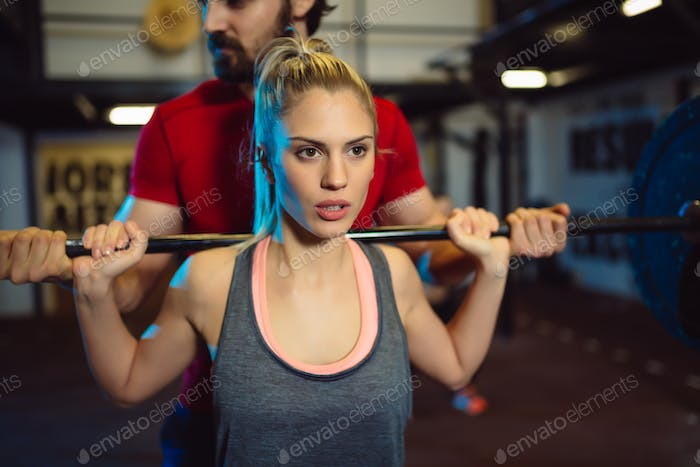 Young woman exercise in order to stay fit