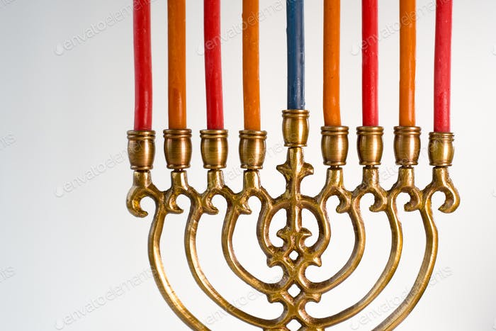 Brass hanukkah menorah with candles closeup