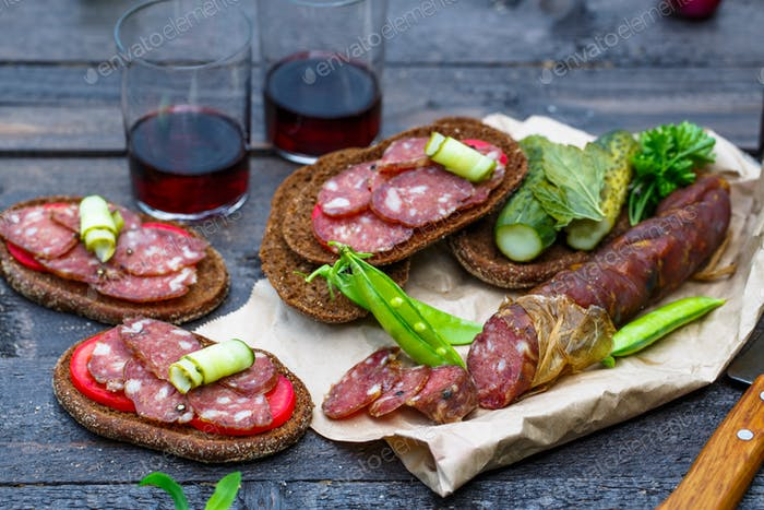 Homemade smoked sausage with rye bread and wine
