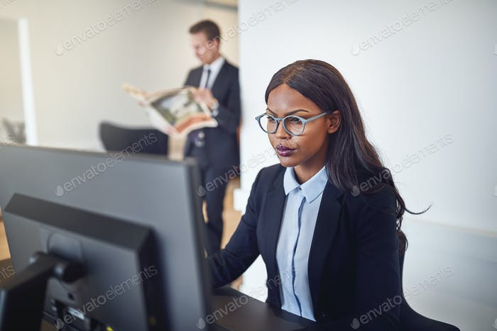 African American businesswoman working on a computer in an office