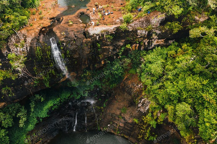 Aerial view from above of the Tamarin waterfall seven cascades in the tropical jungles of the island