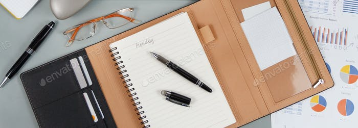 Opened agenda with handwritten MONDAY on a grey