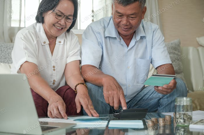 Retirement men and women check their savings with a happy expression.