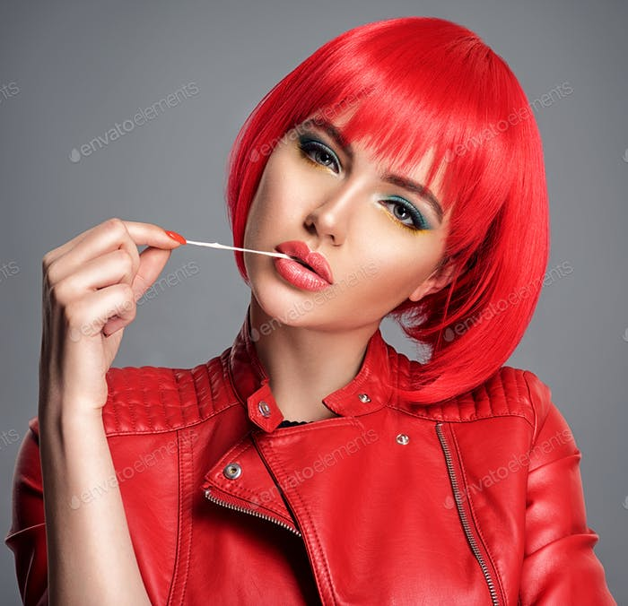 Beautiful sexy woman with bright red bob hairstyle. Fashion  mod