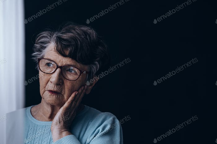 Old woman in dark room