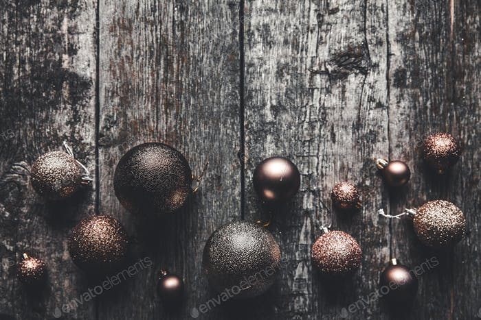 Christmas or New Year background. Vintage Christmas tree decoration balls garland wooden background