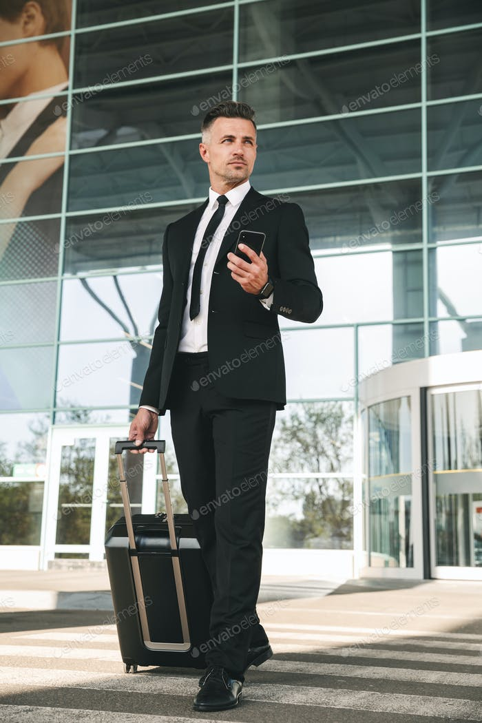 Concentrated businessman dressed in suit