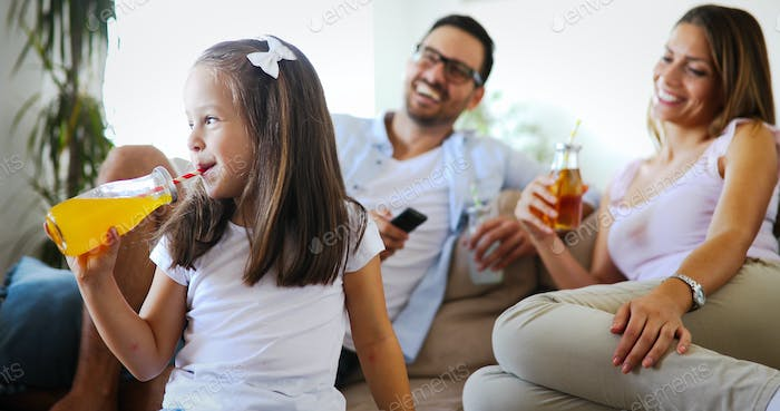 Young little girl enjoying time with her parents