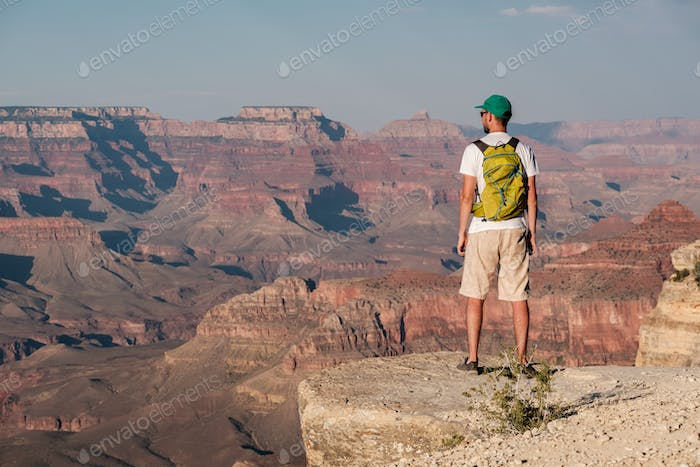 Tourist with backpack at Grand Canyon