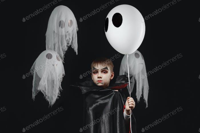Vampire boy with black high bat collar