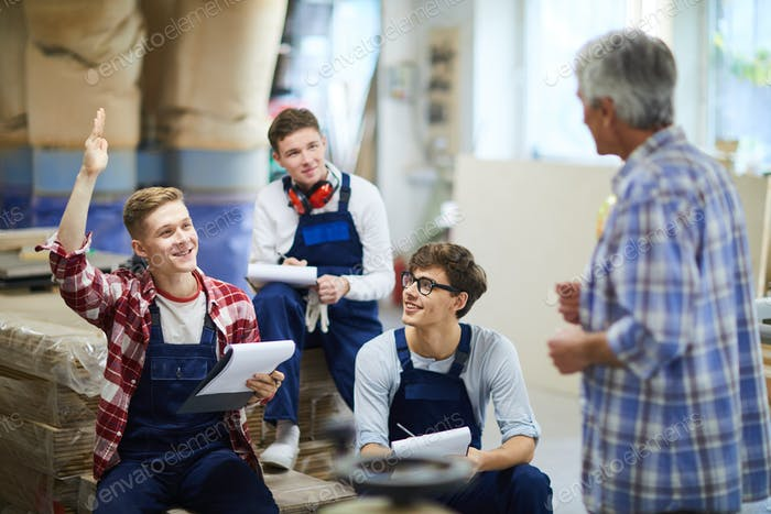 Content guy having question at carpentry class