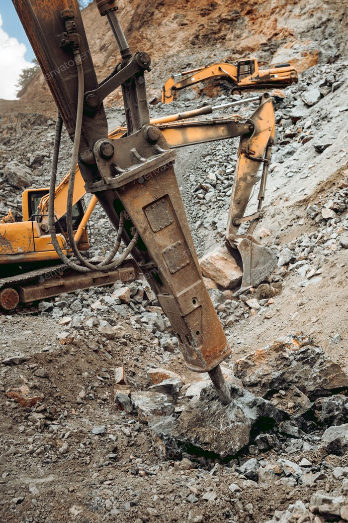 Hydraulic crusher excavator backhoe machinery working on site demolition