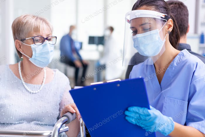 Medical staff wearing visor