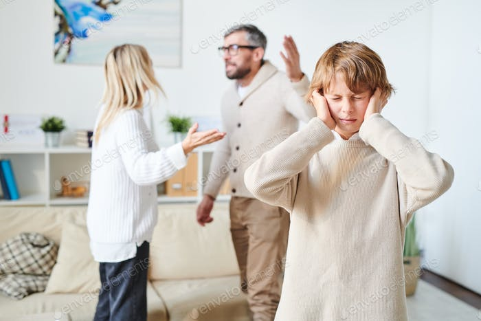 Distraught son suffering from parents conflict