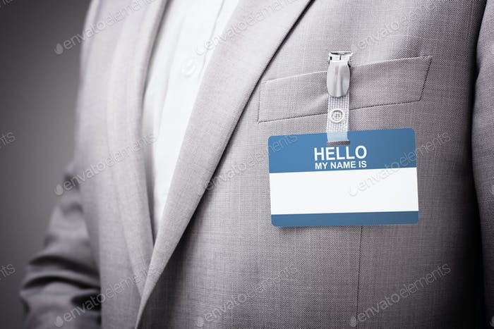 Businessman wearing Hello my name is tag