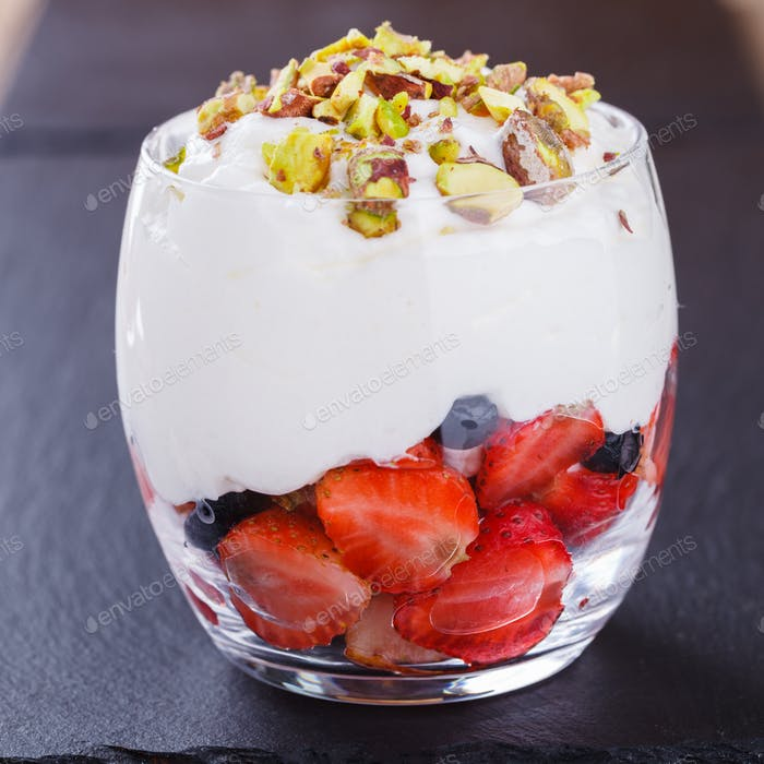 Vanilla mousse with strawberries, blueberries and pistachios
