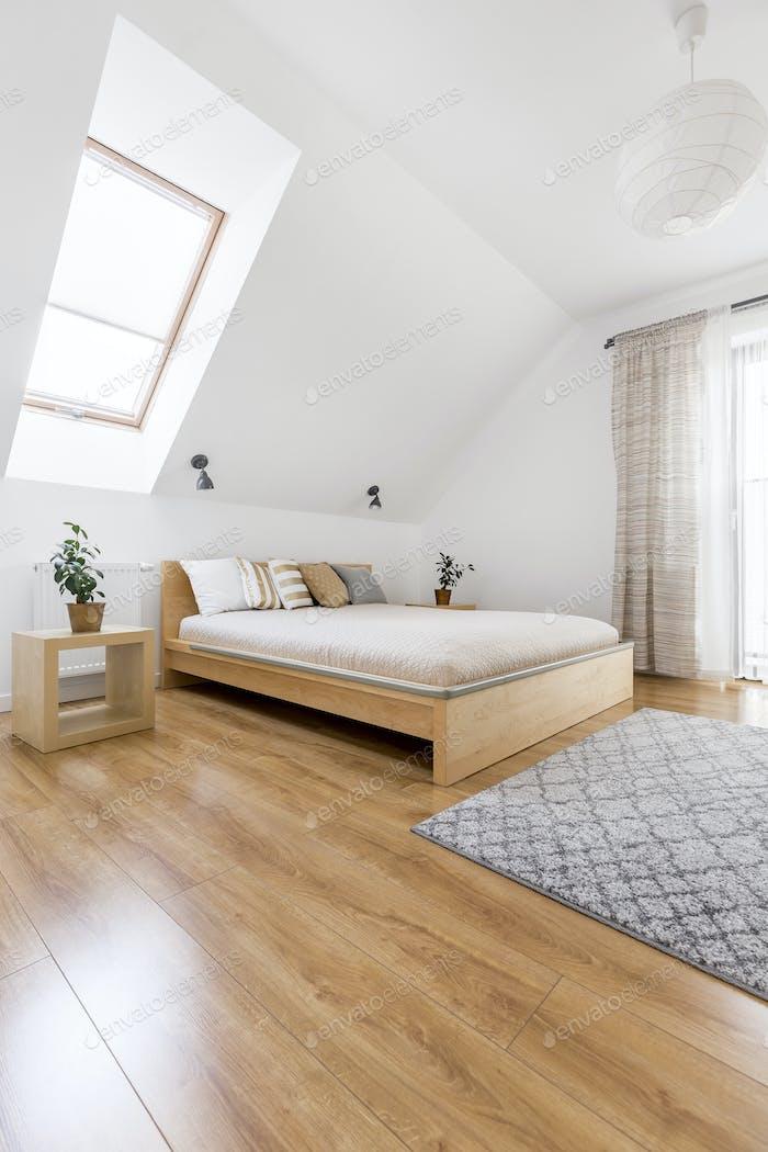 Wooden bed in cozy bedroom