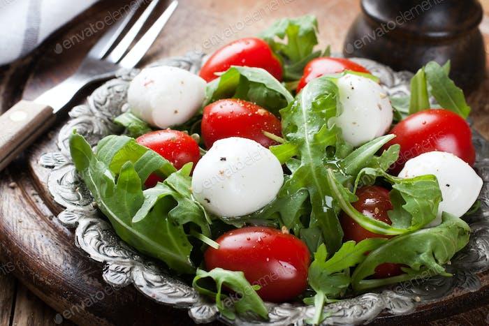 Fresh italian salad with mozzarella cheese