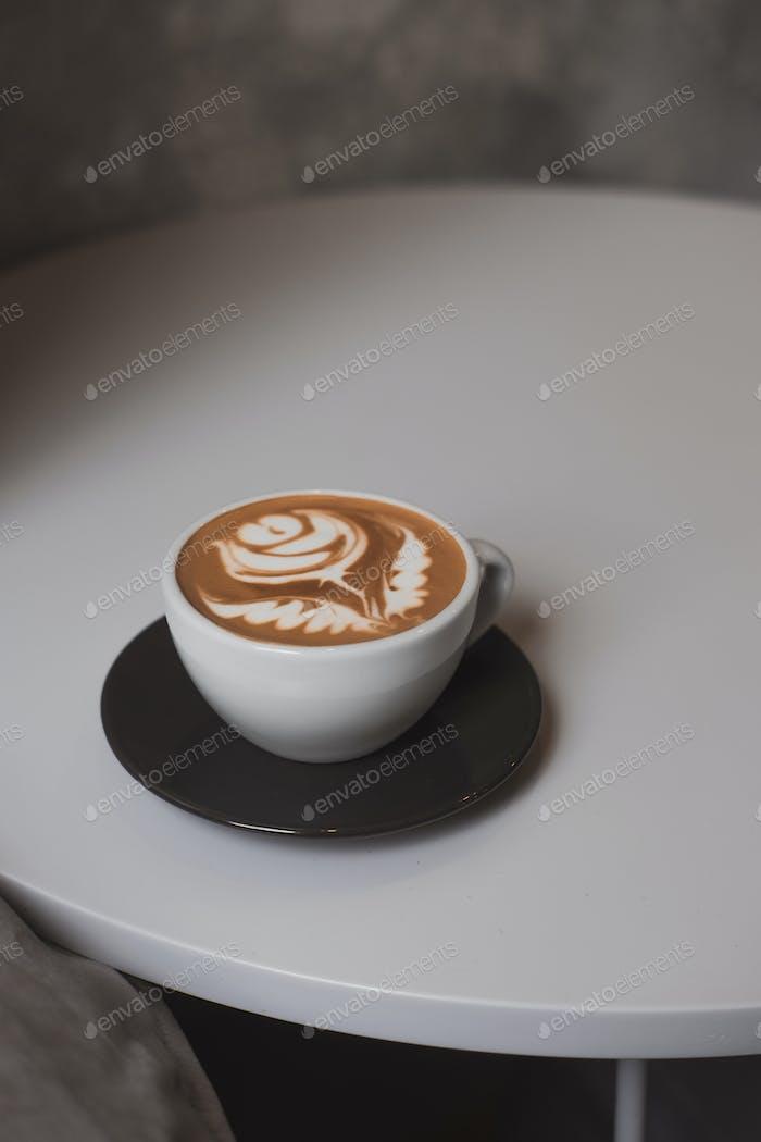 Flower latte art on white table minimalist lifestyle