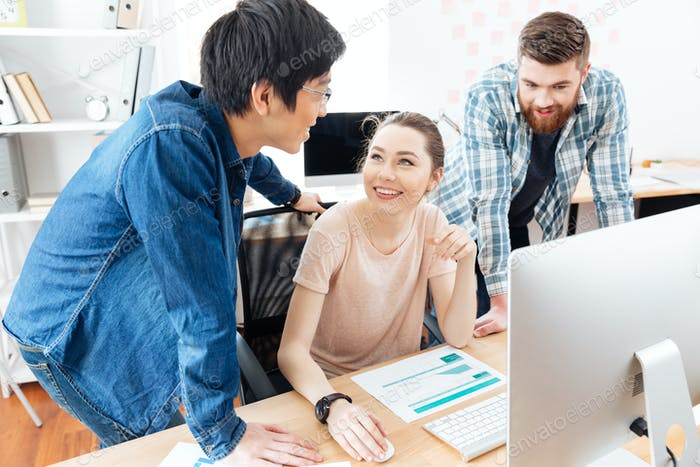 Three businesspeople working in office together
