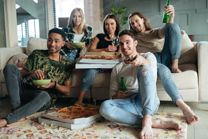 Image of happy five friends watching TV