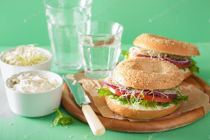 tomato sandwich on bagel with cream cheese onion lettuce alfalfa