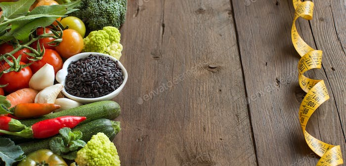 Uncooked black rice in a bowl with vegetables