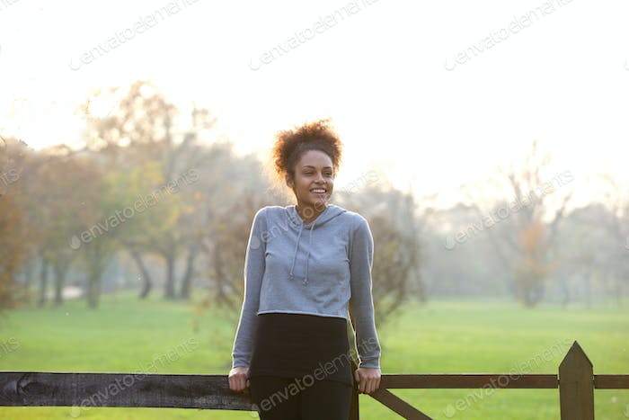 Happy young woman standing outdoors in nature