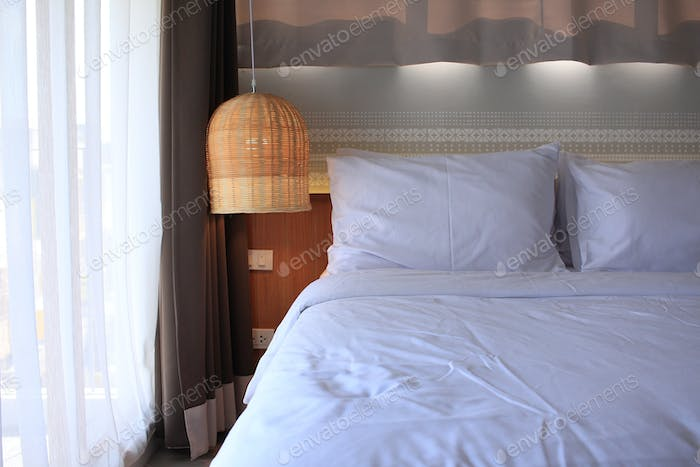 Bedroom with rattan lamp