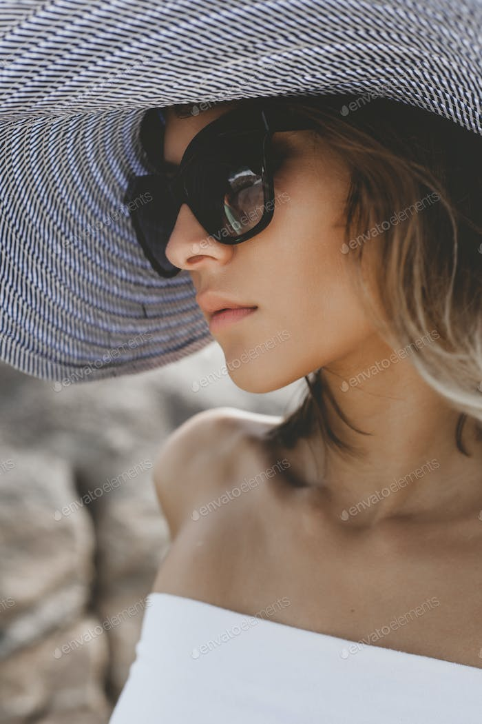 Girl wearing hat and sunglasses