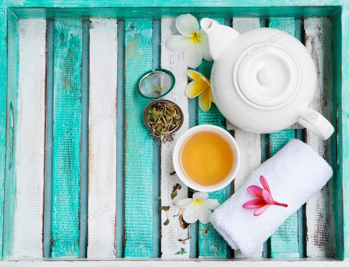 Green Tea in White Cup and Teapot, Welcome Spa Set. Wooden Colorful Tray.