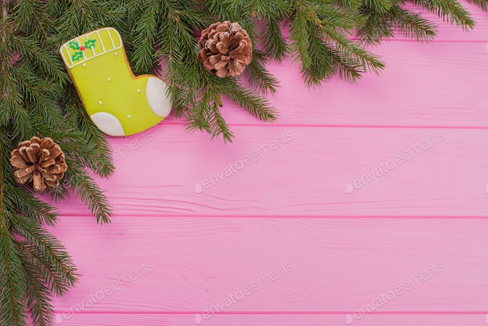 Corner of fresh fir branches and decorations.