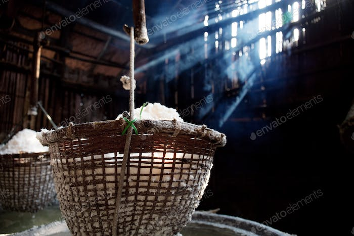 Salt basket hanging on fireplace