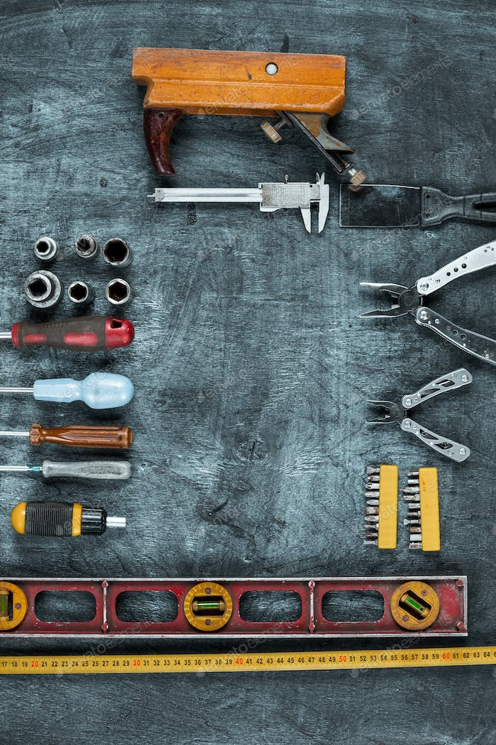 The set of construction tools on wooden table