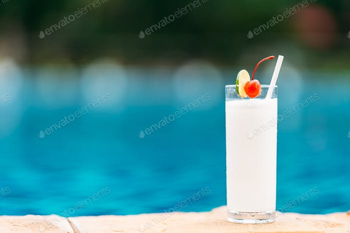 Coconut juice drink around swimming pool in hotel resort